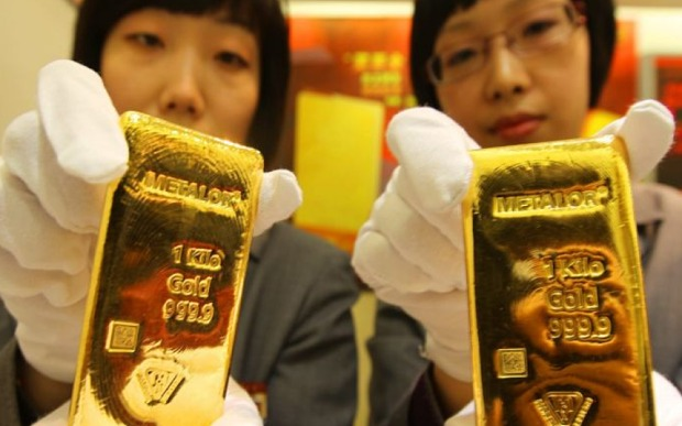 "China's historic devaluation of the yuan this summer fuelled a gold bar and coin ""buying spree"" Photo: EPA"